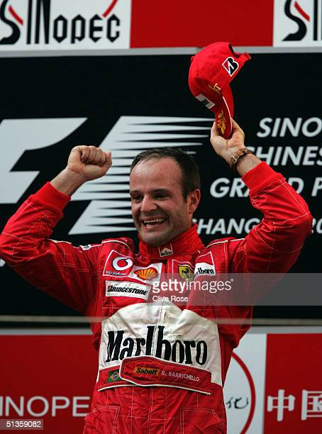 Rubens Barrichello of Brazil and Ferrari celebrates on the podium at the Formula One Chinese Grand Prix at Shanghai International Circuit on...