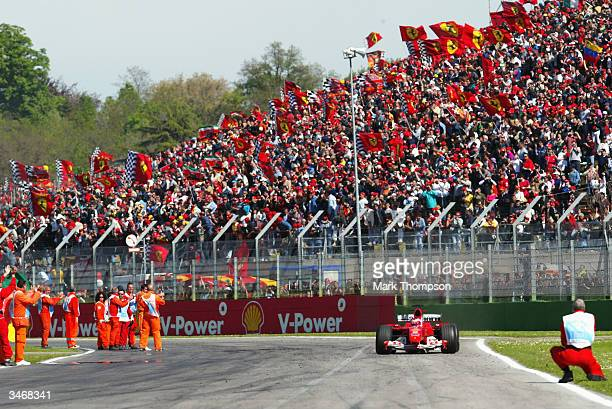 Rubens Barrichello of Brazil and Ferrari crosses the finish line during the San Marino F1 Grand Prix on April 25 at the San Marino circuit in Imola,...