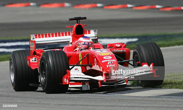 Rubens Barrichello of Brazil and Ferrari drives during the practice session prior to qualifying for the United States F1 Grand Prix at the...