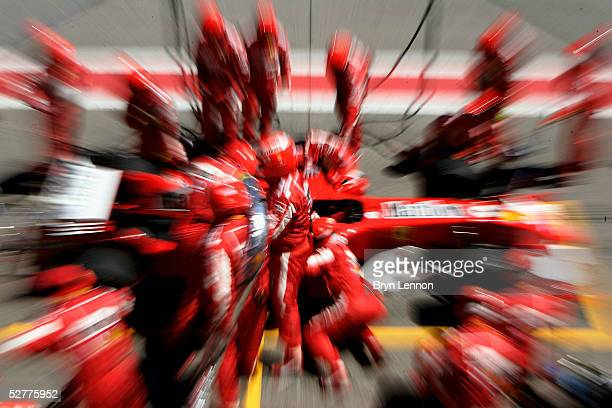 Rubens Barrichello of Brazil and Ferrari makes a pit stop during the Formula One Spanish Grand Prix at the Circuit de Catalunya on May 8 2005 in...