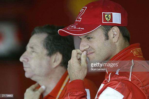 Rubens Barrichello of Brazil and Ferrari stands with Technical Director Jean Todt during the qualifying session for the Formula One British Grand...