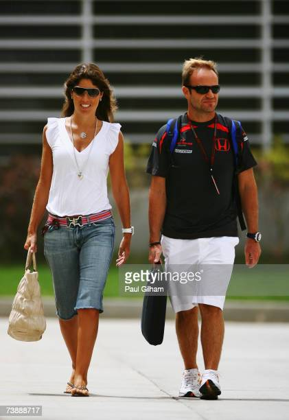 Rubens Barrichello of Brazil and Honda Racing and his wife Sylvana Barrichello walk in the paddock before the Bahrain Formula One Grand Prix at the...