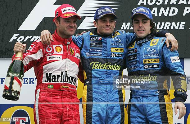 Rubens Barrichello of Brazil and the Ferrari Team Giancarlo Fisichella of Italy and the Renault Team Fernando Alonso of Spain and the Renault Team...