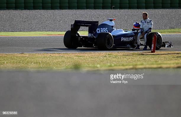 Rubens Barrichello of Brazil and Williams sits on his car after it broke down at the Ricardo Tormo Circuit on February 1, 2010 in Valencia, Spain.