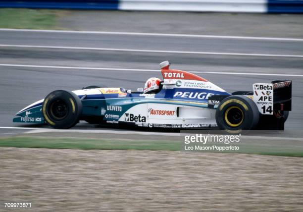 Rubens Barrichello of Brazil enroute to placing ninth, driving a Jordan 195 with a Peugeot A10 3.0 V10 engine for Total Jordan Peugeot, during the...