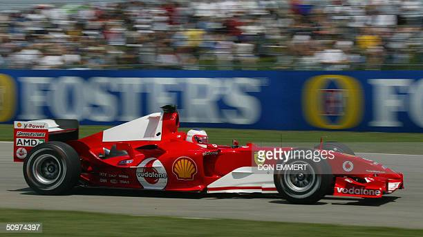 Rubens Barrichello of Italy drives past the crowd during practice 18 June at the US Grand Prix at the Indianapolis Motor Speedway in Indianapolis IN...