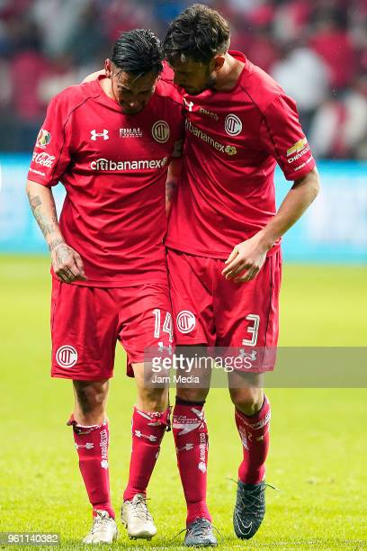 Rubens Sambueza and Santiago Garcia of Toluca look dejected after being defeated in the Final second leg match between Toluca and Santos Laguna as...