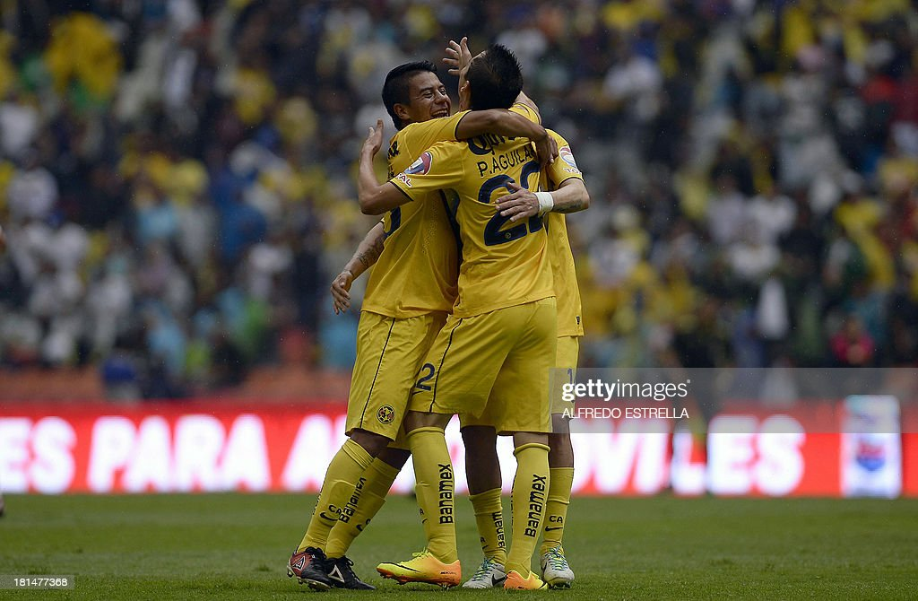 Rubens Sambueza (L) of America celebrates his goal against Jaguares with his teammates Juan Valenzuela (L) and Paul Aguilar, during their Mexican Clausura 2013 tournament football match, in Mexico City, on September 21, 2013. AFP PHOTO/Alfredo Estrella