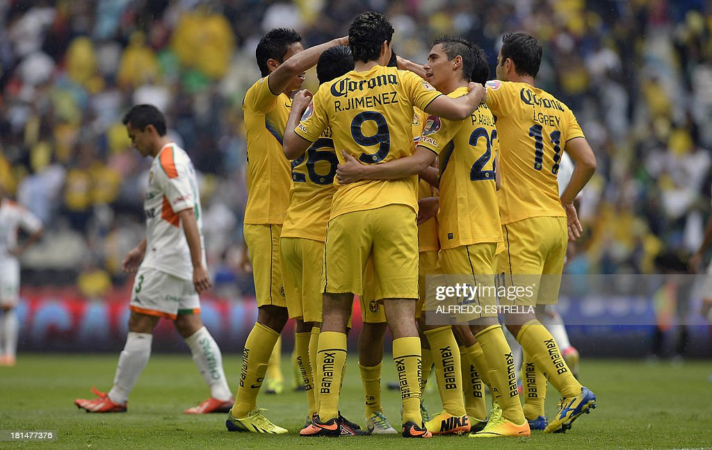 Rubens Sambueza (unseen) of America celebrates his goal against Jaguares with his teammates, during their Mexican Clausura 2013 tournament football match, in Mexico City, on September 21, 2013. AFP PHOTO/Alfredo Estrella