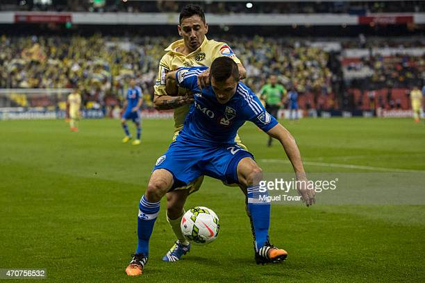 Rubens Sambueza of America fights for the ball with Donny Toia of Montreal Impact during a Championship first leg match between America and Montreal...