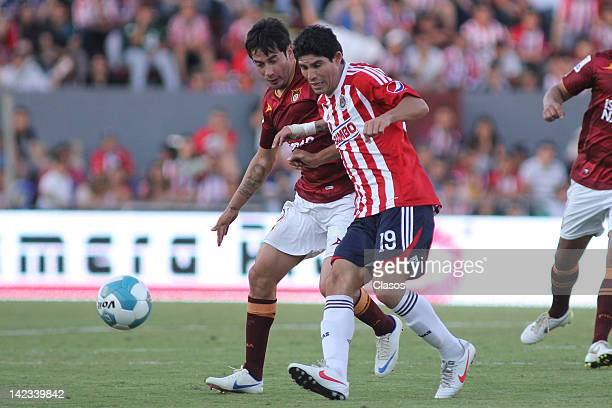 Rubens Sambueza of Estudiantes and Jonny Magallon of Chivas struggles for the ball during a match between Estudiantes v Chivas as part of Clausura...
