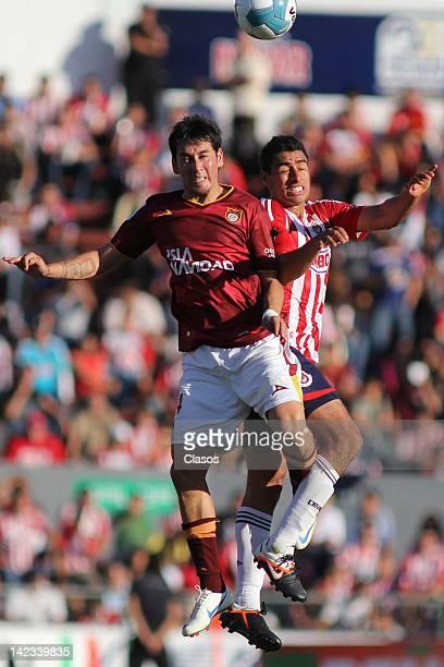 Rubens Sambueza of Estudiantes and Patricio Araujo struggles for the ball during a match between Estudiantes v Chivas as part of Clausura 2012 at 3...