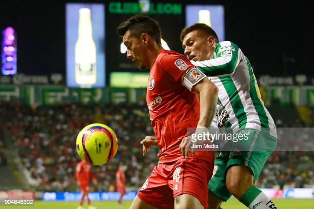 Rubens Sambueza of Toluca and Juan Cornejo of Leon fight for the ball during the second round match between Leon and Toluca as part of the Torneo...