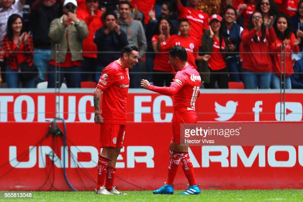 Rubens Sambueza of Toluca celebrate with teammate Ángel Reyna after scoring the second goal of his team during the quarter finals second leg match...