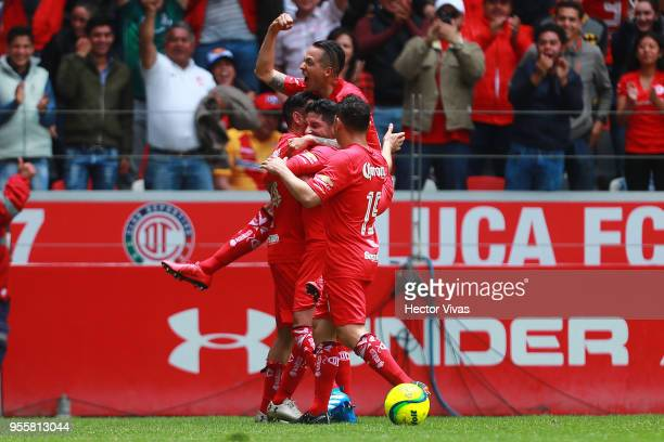 Rubens Sambueza of Toluca celebrate with teammates after scoring the second goal of his team during the quarter finals second leg match between...