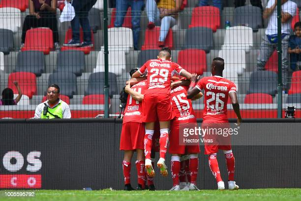 Rubens Sambueza of Toluca celebrates with teammates after scoring the second goal of his team during the 1st round match between Toluca and Morelia...
