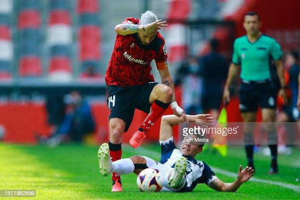 Rubens Sambueza of Toluca fights for the ball with Arturo Gonzalez of Monterrey during the 14th round match between Toluca and Monterrey as part of...