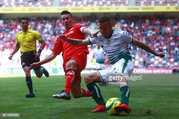 Rubens Sambueza of Toluca struggles for the ball with Jonathan Rodriguez of Santos Laguna during the 8th round match between Toluca and Santos Laguna...