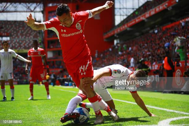 Rubens Sambueza of Toluca struggles for the ball with Josecarlos Van Rankin of Chivas during the third round match between Toluca and Chivas as part...