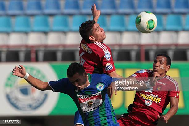 Rubert Quijada and Romulo Otero of Caracas FC fight for the ball during a match between Llaneros de Guanare and Caracas FC as part of the Clausura...