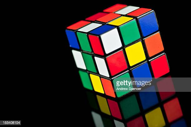 Rubik's Cube toy on black background with reflection