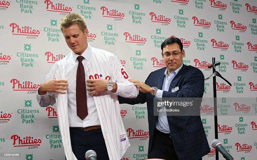 Rubin Amaro Jr. (R) helps Jonathan Papelbon of the Philadelphia Phillies put on his new uniform as Papelbon's signed a four-year, $50,000,058 contract, at Citizens Bank Park on November 14, 2011 in Philadelphia, Pennsylvania.