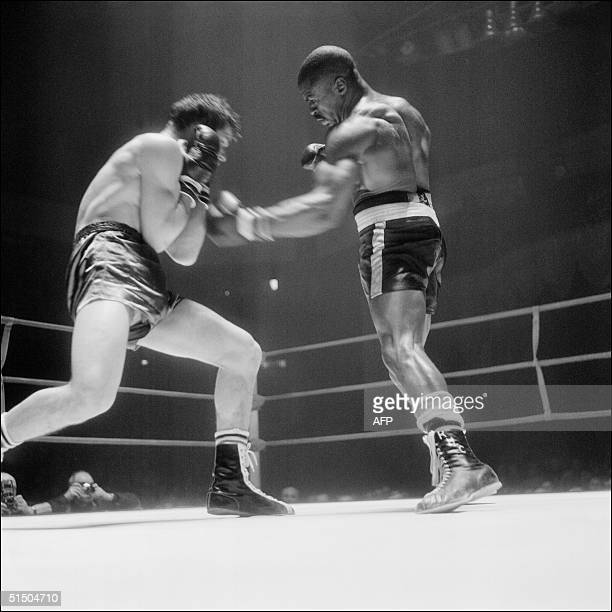 Rubin Carter lands a punch on Fabio Bettini of Italy during their international middleweight match in Paris 22 February 1965 Carter beat Bettini by...