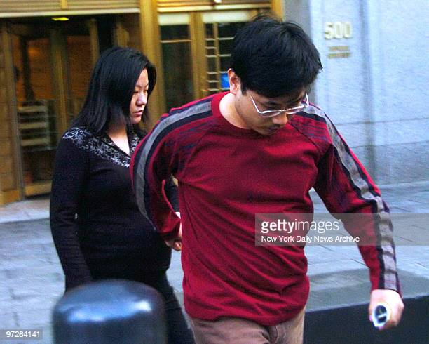 Rubin Chen and his wife Jennifer Wang as they rush out of Federal Court after being charged with insider trading