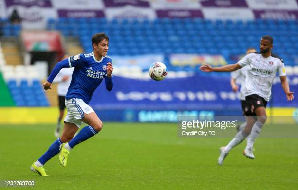 Rubin Colwill of Cardiff City FC and Michael Ihiekwe of Rotherham United during the Sky Bet Championship match between Cardiff City and Rotherham...