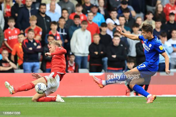 Rubin Colwill of Cardiff City scores his sides second goal despite the challenge from Joe Worrall of Nottingham Forest during the Sky Bet...