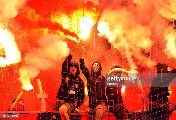 Rubin Kazan fans light flares during the Russian Football League Championship match between FC Rubin Kazan and PFC CSKA Moscow at the Tsentraliniy...