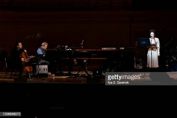 Rubin Kodheli, Philip Glass and Sandra Oh perform on stage during the 33nd Annual Tibet House US Benefit Concert & Gala on February 26, 2020 in New...