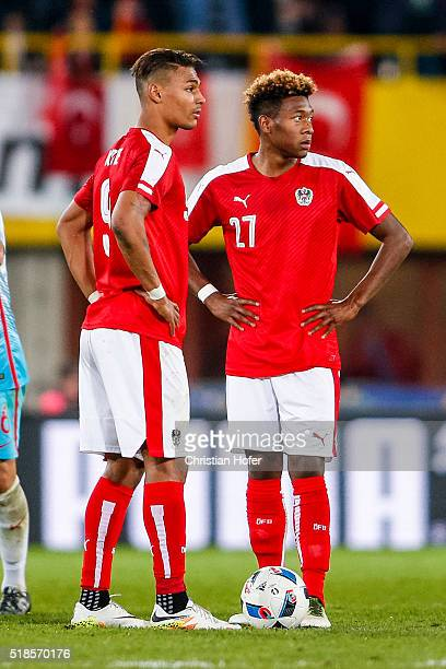 Rubin Okotie and David Alaba of Austria look dejected after recieving a goal during the international friendly match between Austria and Turkey at...