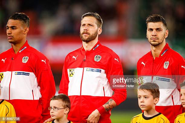 Rubin Okotie Guido Burgstaller and Aleksandar Dragovic of Austria line up during the national anthem prior to the international friendly match...