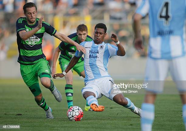 Rubin Okotie of 1860 Muenchen battles for the ball with Gylfi Sigurdsson of Swansea during the preseason friendly match between TSV 1860 Muenchen and...