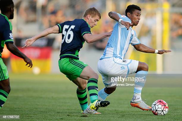 Rubin Okotie of 1860 Muenchen battles for the ball with Jay Fulton of Swansea during the preseason friendly match between TSV 1860 Muenchen and...