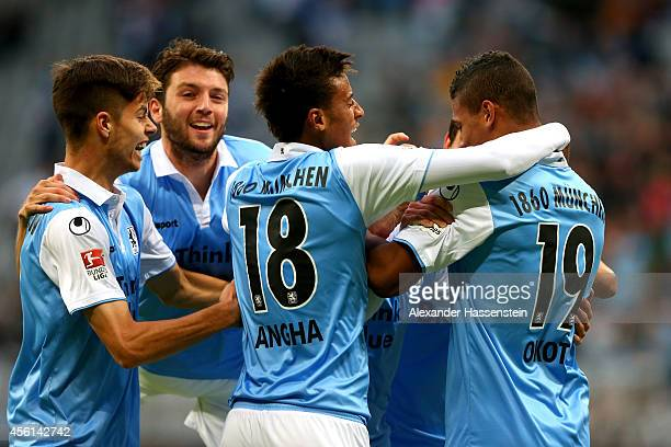 Rubin Okotie of 1860 Muenchen celebrates scoring the opening goal with his team mates Julian Weigl , Ilie Sanchez and Martin Angha during the Second...