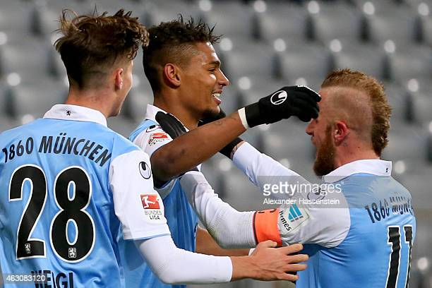Rubin Okotie of 1860 Muenchen celebrates scoring the opening goal with his team mates Daniel Adlung and Julian Weigl during the Second Bundesliga...