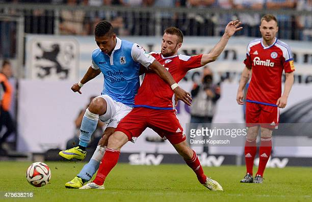 Rubin Okotie of Muenchen is challenged by Jaroslaw Lindner of Kiel during the 2 Bundesliga playoff second leg match between 1860 Muenchen and...