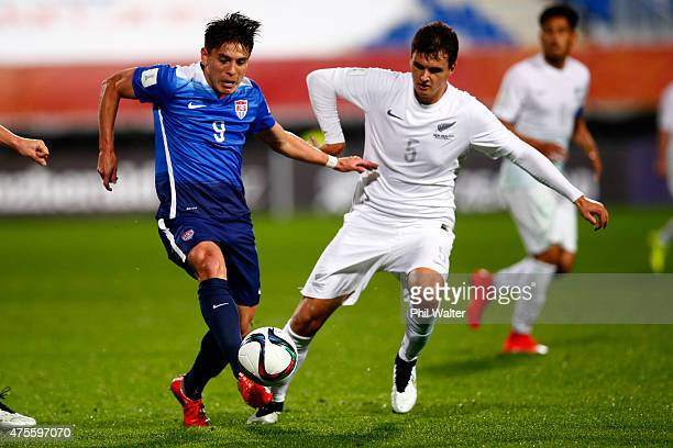 Rubio Rubin of the USA is put under pressure from Adam Mitchell of New Zealand during the FIFA U20 World Cup New Zealand 2015 Group A match between...