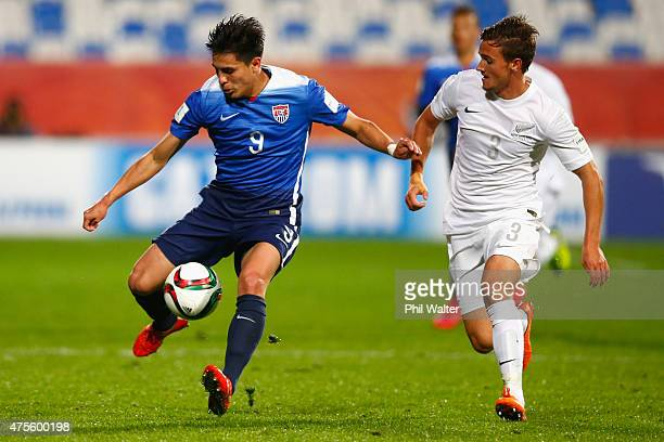 Rubio Rubin of the USA takes the ball forward past Moses Dyer of New Zealand during the FIFA U20 World Cup New Zealand 2015 Group A match between New...