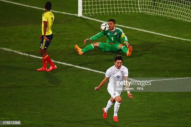 Rubio Rubin of USA celebrates his team's first goal as goalkeeper Alvaro Montero and Jeison Angulo of Colombia reactduring the FIFA U20 World Cup New...