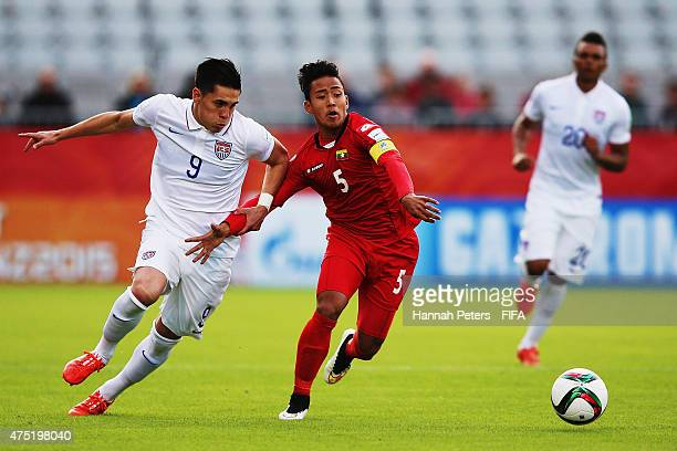 Rubio Rubin of USA competes with Nanda Kyaw of Myanmar for the ball during the FIFA U20 World Cup Group A match between USA and Myanmar at the...