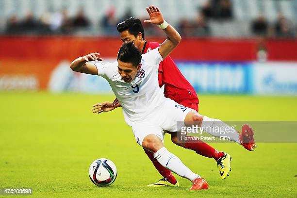 Rubio Rubin of USA is brought down during the FIFA U20 World Cup Group A match between USA and Myanmar at the Northland Events Centre on May 30 2015...