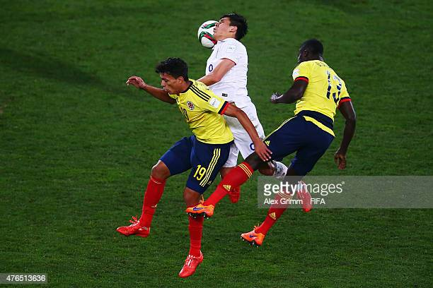 Rubio Rubin of USA jumps for a header with Victor Gutierrez and Davinson Sanchez of Colombia during the FIFA U20 World Cup New Zealand 2015 Round of...