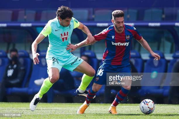 Rubén Rochina of Levante UD challenges for the ball with Jesús Vallejo of Granada CF during the La Liga Santander match between Levante UD and...
