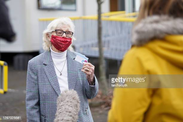 Ruby Archer, 87 from Leeds speaks to a television reporter after she receives the AstraZeneca/Oxford University Covid-19 vaccine at the Askham Bar...