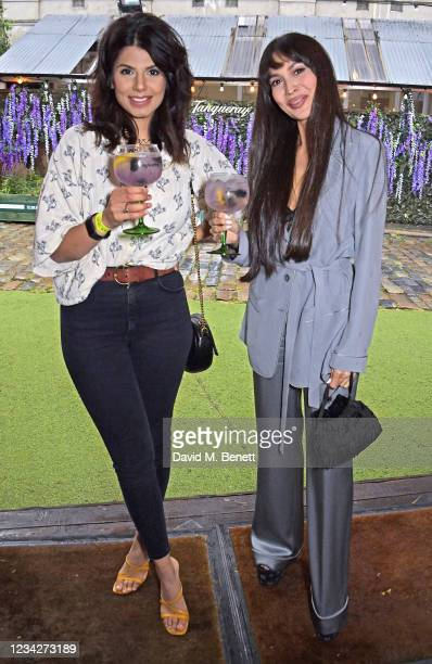 Ruby Bhogal and Zara Martin attend the launch of the Tanqueray Gin Summer Garden at Flat Iron Square on July 28, 2021 in London, England.