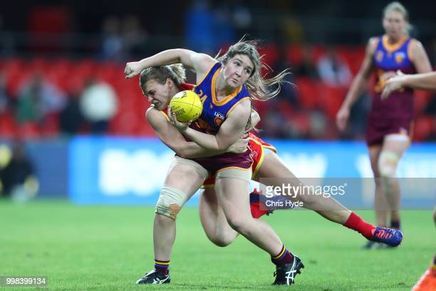 Ruby Blair of the Lions is tackled during the AFLW Winter Series match between the Gold Coast Suns and the Brisbane Lions at Metricon Stadium on July...