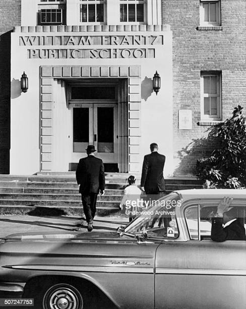 First grade Negro girl Ruby Bridges is escorted by US Federal Marshals into William Frantz elementary school during the second week of the court...